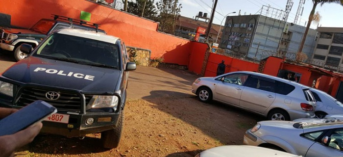 A police truck parked inside ActionAid Uganda offices. Credit: The Observer