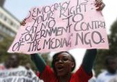 Civil society activists demonstrate in Nairobi against a proposed repressive NGO law in a growing global trend to stifle activism. (Photo credit: Evans Habil/Nation Media Group)