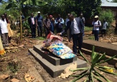 Human Rights Defenders at the funeral of Emmanuel, the guard who was killed during the break-in at HRAPF a few weeks ago. Credit: HRW