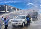 Ugandan police use water cannon to spray a procession of FDC's Kizza Besigye. Internet photo.