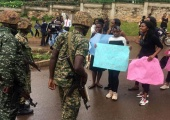 Soldiers confront students protesting tuition increment at Makerere University on October 22, 219. Photo by Alex Esagala