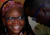 Dr. Stella Nyanzi speaks with her lawyer Nicholas Opiyo at Buganda Road Court on April 10, 2017 during her court appearance. © 2017 Reuters